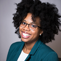 Lataevia Berry headshot in green blazer